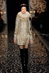 Look 27 - Coat  - GOLD/STONE FILIGREE BROCADE COAT .  Accessories -  IVORY SHEARLING SCARF