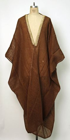 Syria or Iraq woven abaya in camel fur trimed in brushed gold cord.
