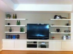 Built in Basement Home Theater using 3 BESTÅ shelf units, 4 BESTÅ VARA drawer fronts and 6 Lack wall shelves
