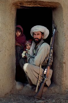 Pashtun and his family, with and old Lee-Enfield. Pin by Paolo Marzioli