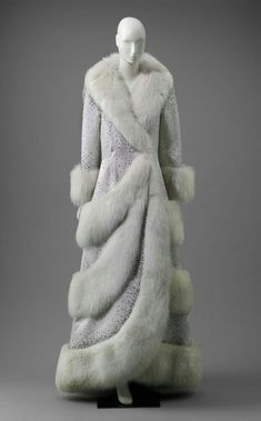 Long white coat of silk satin weave and white fox fur. Large shawl collar of white fox fur along with long sleeves and fox fur cuffs. Throughout the coat are graduatin … Vintage Dresses, Vintage Outfits, Vintage Fashion, Vintage Clothing, Edwardian Fashion, Gothic Fashion, Vintage Coat, Mode Vintage, Fur Fashion