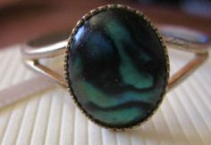 New Listing Started Silvertone one size ring with oval abalone stone £0.55
