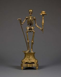 Pair of Gilt-Brass Single-Light Candelabra in the Form of Skeletons   From a unique collection of antique and modern candleholders and candelabra at https://www.1stdibs.com/furniture/lighting/candleholders-candelabra/