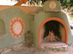 Cob fireplace - this would be awesome at my parents house on the patio near the pool area. Dad would certainly need to watch out for Mom if she had another fire place...