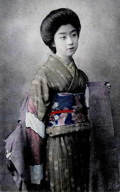 Geisha Otomaru taking off her Haori 1910s. I wasn't sure about this image, but I found a very similar photo of the same woman in a book about Geisha published in 1917. Although, the book didn't give her name, I think that this is Otomaru a Shinbashi Geisha from Tokyo.