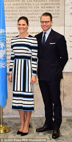 Princess Victoria seemed to be in high spirits as she posed for photos with her husband...