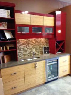love the high gloss red cabinets