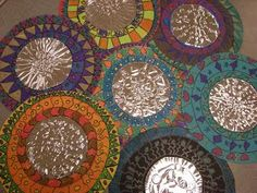 3rd Grade Mexican Folk Art Mirrors, She uses tooling tin (use heavy foil?) and craft paper--lids of different sizes for tracing circles.