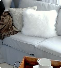DIY fur pillows. Can't find one? Make it yourself out of fur rugs like this lady did. In to the real stuff... repurpose a thrift store fur coat? I haven't priced faux fur in a long time, shouldn't be bad.  I could stuff it with all those pesky plastic grocery bags I always have too many of!