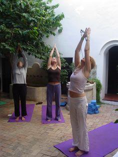 Morning Yoga Sun Salutations in hotel courtyard at Yoga Breaks in Spain.  www.yogabreaks.org.uk
