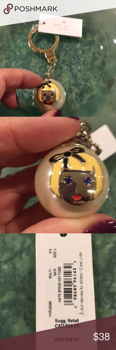 NWT Kate spade Virgo key chain/ charm NWT Kate Spade Virgo key chain/ charm. Gold tone hardware. Enameled little girls face with blue crystal eyes. kate spade Accessories Key & Card Holders