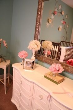vintage inspired nursery-- Dresser is cute..... turn it into a cute changing table with the top drawers for changing table stuff, etc. and the bottom ones for clothing that is out of season, extra diapers, etc.