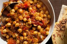 Chole (Chana) Masala - really good!  I did the sauteeing on the cooktop, then put that stuff and the tomatoes and chickpeas in the crockpot for 3 hours on low.  Left out the water for the slow cooker.