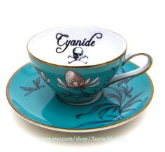 Poison Tea Cup and Saucer Cyanide Gothic French Blue and Gold altered china Chase and Scout. $38.00, via Etsy.
