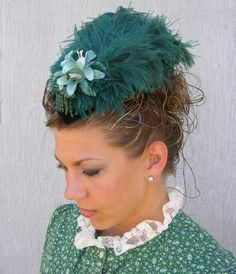Emerald's hats offer a unique and versatile accessory to late 1800, Victorian style fashion.   By combining a basic teardrop style hat frame with a variety of clip on feather accesories, a number   of fashion looks can be achieved.