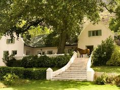 Typical Cape Dutch home - we all need a horse at our front door! Eerste Rivier