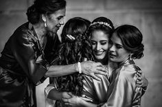 Emotions will be running high on your wedding morning. Get your photographer to snap a few candid shots of you, your mom and your sisters hugging as you get ready to walk down the aisle.