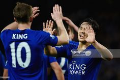 Andy King of Leicester City celebrates scoring his team's second goal with his team mate Shinji Okazaki during the Barclays Premier League match between Leicester City and West Bromwich Albion at The King Power Stadium on March 1, 2016 in Leicester, England.