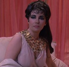 Cleopatra is ready to go to sleep until Marc Anthony decides to talk to her http://mariaefmilliner.com/cleopatra-a-review-of-the-35-dresses-she-wears-on-the-movie/