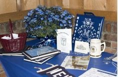 class reunion registration table with yearbooks