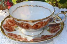 Japan, tea cup and saucer, beautiful big brown roses