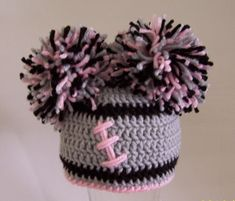 Crocheted baby girl football beanie  Oakland Raiders, or Any Team Any Color Combination Cute photo prop. $20.00, via Etsy.