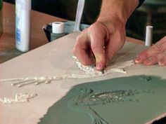 How to Make Plaster Relief Walls  Allow plaster designs to dry, then use craft knife to carve details as desired.