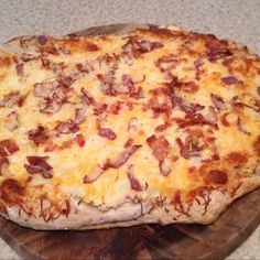 Garlic mashed potato pizza with bacon leeks and potato skins