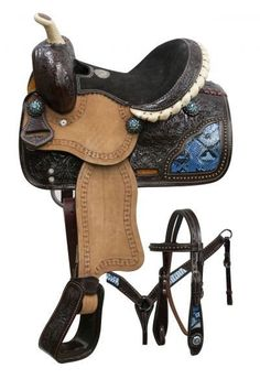 Double T pony saddle set with blue snake print inlays. This saddle features dark oil floral tooled skirts, pommel and cantle with rough out fenders . Pony Saddle, Stirrup Leathers, Western Horse Tack, Western Saddles, Horse Accessories, Headstall, Riding Gear, Horse Saddles, Blue Crystals