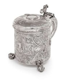 A probably Danish ornament pattern silver tankard on three feet, early 18th ct.Photo Nagel Auktionen
