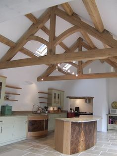 Oak trusses for vaulted ceiling in kitchen. Could extend out to the oak/glass gable end.
