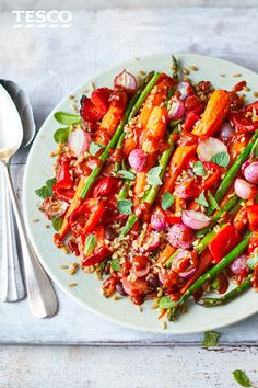 This vegetarian bowl is a celebration of spring flavours. With tendersweet carrots, asparagus and mint and tossed with a punchy harissa and honey dressing, this makes an ideal midweek meal. To make this gluten-free, use a pack of wholegrain rice and swap the honey for maple syrup for a vegan option.   Tesco