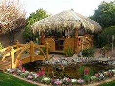 tiki hut koi pond with bridge more tiki huts thatched roof outdoor
