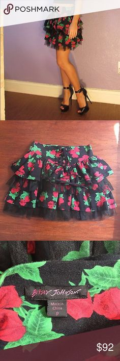 BETSEY JOHNSON tin can rose print skirt corset tie Betsey Johnson adorable tin can mini party skirt. Black with red rose floral print. Jersey knit cotton/spandex with lots of stretch. Tiered with cute tulle layers. Corset style lace up in front. Size P (XS). Across the waist 12 inches, length 16. Preowned. Fabric shows wear from washing (see close-up photos).  Fabric may wrinkle during shipping. Smoke free, pet free home. Sexy and unique!! Betsey Johnson Skirts