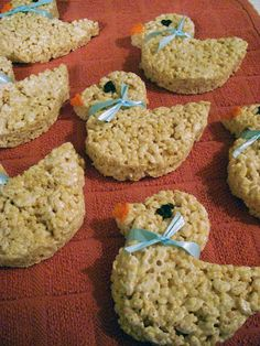 Baby shower rice krispie treats! Could use a pink or blue ribbon depending on gender.