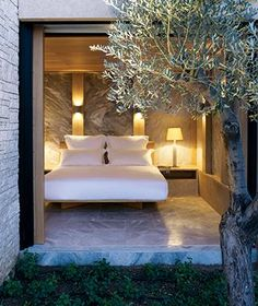 Stone columns, acres of olive trees, and panoramic sea views accompany the 38 plunge-pooled guest pavilions at Amanzo'e resort in Porto Heli, #Greece. #TL_ItList