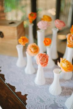 single blooms in milk vases | Photography by sheachristine.com | Design + Planning by alovefordetail.com | Floral Design by juliarohdedesigns.com |   Read more - http://www.stylemepretty.com/2013/07/11/miami-wedding-from-shea-christine-a-love-for-detail/