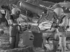 Two astronauts operate a powerful lunar telescope in a scene from the film 'Destination Moon', a surprisingly accurate prediction of space travel which won an Academy Award for Best Special Effects. The film was directed by Irving Pichel for George Pal Productions.