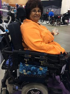 The PremierImperial Evening Blue looks great on her chair, and the adjustable straps will allow her to raise the bag if that ends up being too close to her wheel. (2015 Chicago Abilities Expo)