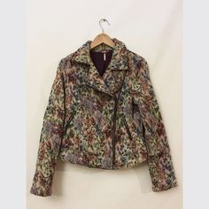 Free people jacket Free people floral jacket. Has a biker jacket cut with a super trendy 80s print. SNAGS all over jacket but no holes or tears.  Low Price firm due to condition Free People Jackets & Coats