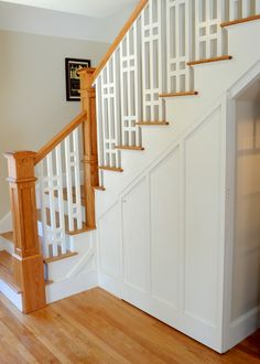 Bungalow Remodel - Stained Oak banister and railing w/ white painted spindle design.