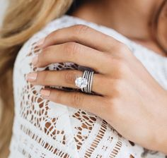 (A.E) I love everything about this.  The oval shape and the thin bands.  I am not certain about the silver/plat tho.