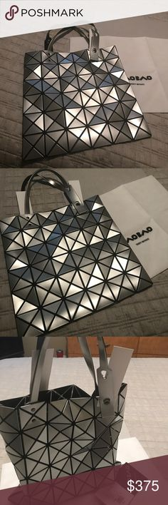 """Issey Miyake Bao Bao bag (authentic) Issey Miyake Bao Bao bag, Authentication card and dust bag included. 13""""X13.5 firm on price, will not let it go for cheap. Issey Miyake Bags Totes"""