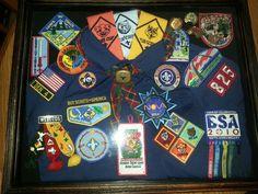 Cub Scout shadow box. ..Alex's shirt, badges, pins, etc.