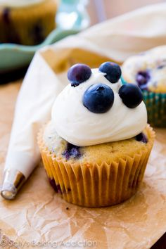 These super moist blueberries 'n cream cupcakes are bursting with vanilla, juicy blueberries, and a hint a lemon.