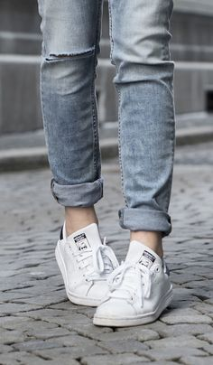 Just The Design: Tiphaine is wearing a pair of denim Cheap Monday jeans with Adidas Stan Smith sneakers