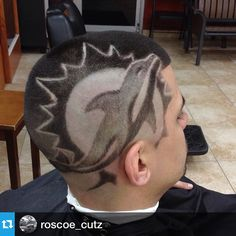 Work done by NBA approved barber @roscoe_cutz out of Headzup Barbershop Dolphins logo haircut design www.nationalbarbersassociation.com