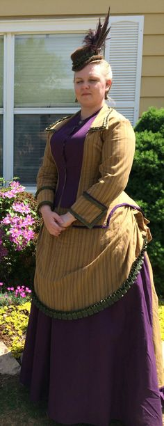 1870s bustle dress made using Truly Victorian patterns. Skirt is TV208, bodice is TV405. Worn with TV101, Petticoat with Wire Bustle. I also knit and felted the hat and decorated it.