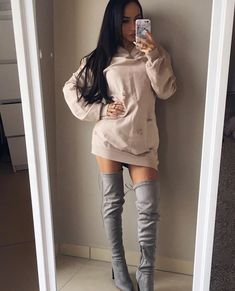 Coco Lili. Gray thigh high boots. Hoodie dress. Nude colored sweater dress. Long brunette hair.