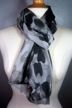 Charcoal black and pewter grey cascade down this sheer, silk georgette scarf in a flurry or artistic brush strokes. It was painted the day I attended a special ceremony with beautiful tribal fires glowing all evening. Before the sunset, the smoke glided up towards the sky, as we all sang and prayed together. It was a sacred moment filled with love and memories.    With these beautiful shades of greys and blacks, this scarf has timeless appeal for any season. Very versatile - wear as a head…